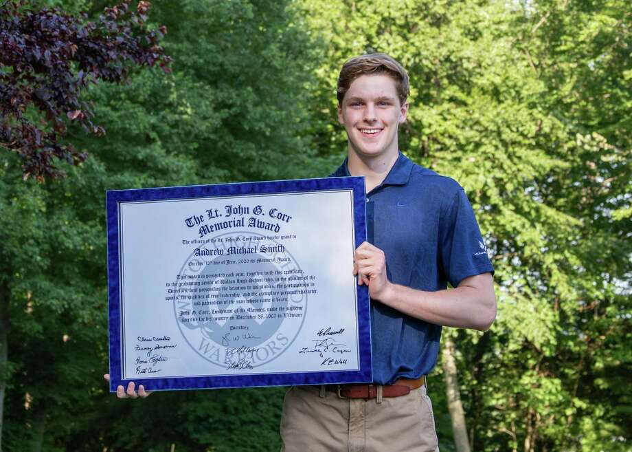 Wilton High senior Andrew Smith was presented with the annual John G. Corr Award at his home last week. Photo: Gretchen McMahon / For Hearst Connecticut Media
