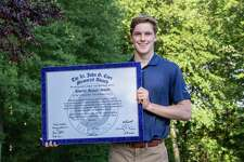 Wilton High senior Andrew Smith was presented with the annual John G. Corr Award at his home last week.