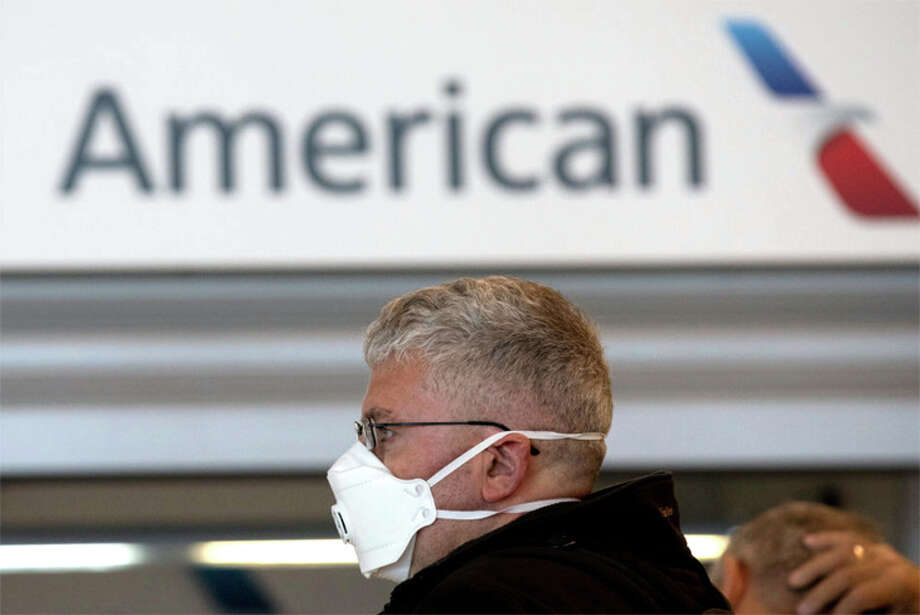 American Airlines says is has plans to deny boarding to passengers without face masks, but might run into problems with enforcement. Photo: Getty Images
