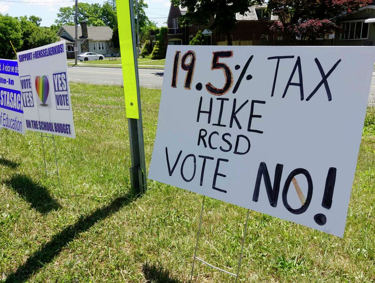 A view of signs dealing with the school budget vote on Washington Ave. on Tuesday, June 16, 2020, in Rensselaer, N.Y. (Paul Buckowski/Times Union)