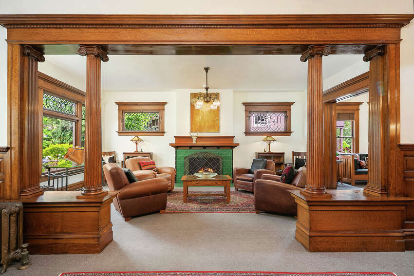 In the main living area, a fireplace and beveled glass create warmth and light.