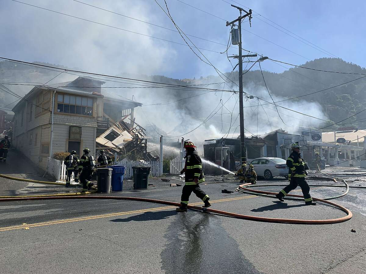 An explosion Wednesday morning in downtown Stinson Beach ignited at least one structurefire and closed a chunk of Highway 1 to traffic, officials said.