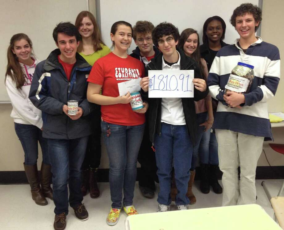 Molly James, front center, and Will Hennessey, far right, pose with their New Canaan High School classmates after they raised money for the Food Bank of Lower Fairfield County during a previous school year in the town's school district. James, and Hennessey also spoke alongside other alumni, and students in the district about diversity in the district, at the town's Board of Education's virtual online meeting at the end of the 2019-2020 school year. Since then, the Board of Education is now educating its students, teachers, and parents about the three parts of a drafted goal that it approved at their recent virtual online meeting, in an effort to work to be more inclusive about the three parts of the goal, which are: Equity, diversity, and inclusion, in the town's public schools. Photo: Contributed Photo / New Canaan News Contributed