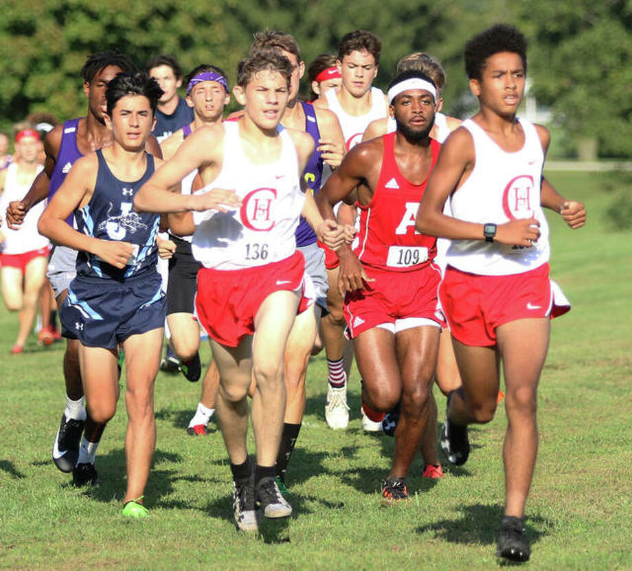 A group of cross country runners take to the course during competition last fall. The IHSA is inching closer to having student athletes return for fall sports. Photo: Greg Shashack | The Telegraph