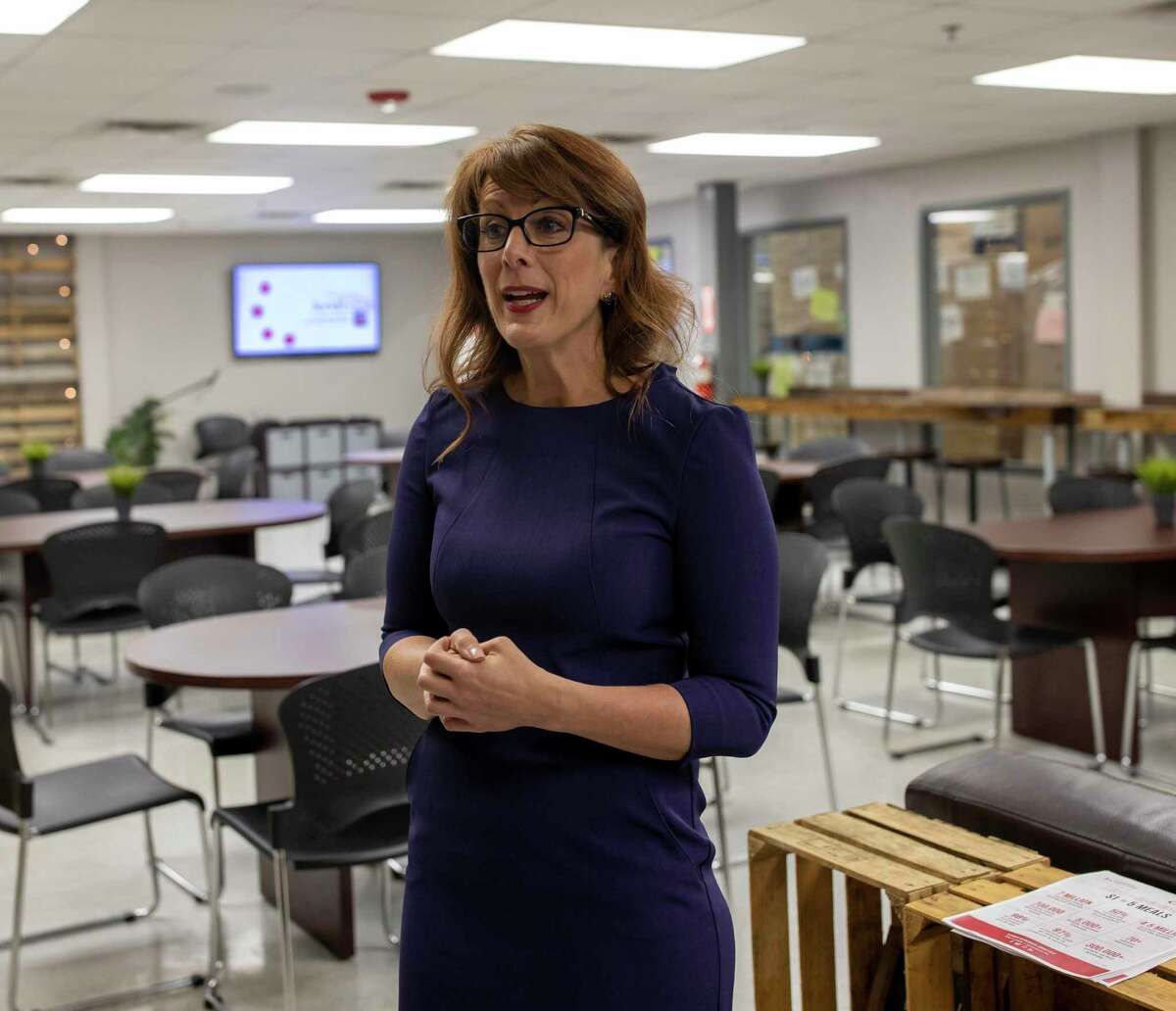 Allison Hulett, former the President and CEO of the Montgomery County Food Bank, speaks inside the volunteer lounge in Conroe, Thursday, Jan. 9, 2020. The organization's board of directors just recently announced the search for Hulett's successor.