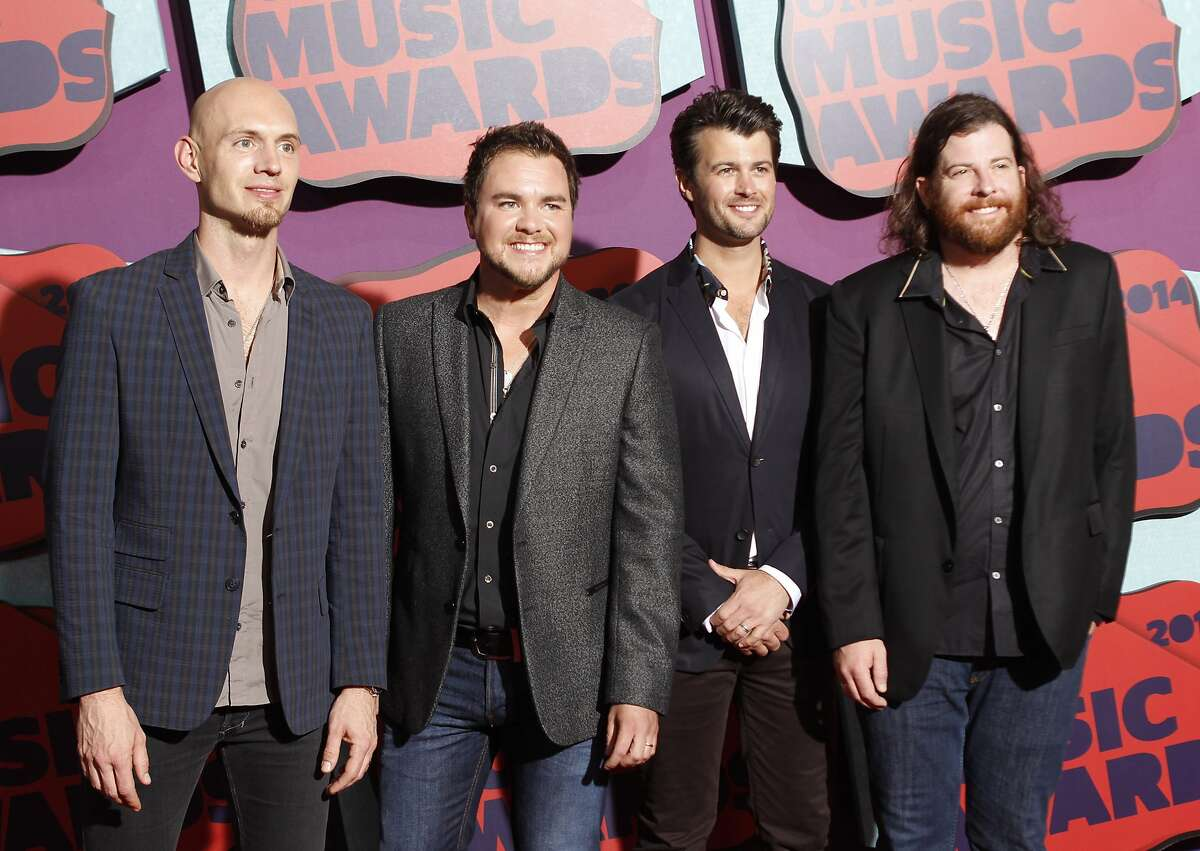 File - This June 4, 2014 file photo shows Jon Jones, from left, Mike Eli, Chris Thompson and James Young of the Eli Young Band at the CMT Music Awards in Nashville, Tenn. The last time bassist Jones played a concert with his country group Eli Young Band was March 8. He hopes to hit the stage again in June to launch a new drive-in concert series in his first return to live music with fans present since the devastating coronavirus. (Photo by Wade Payne/Invision/AP, File)