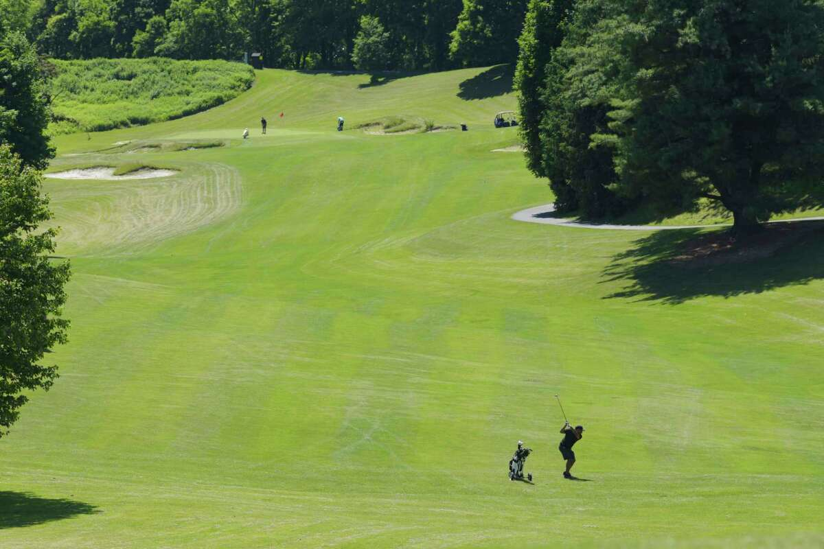 A golfer hits towards the first hole on opening day at Capital Hills Golf Course on Tuesday, June 16, 2020, in Albany, N.Y. (Paul Buckowski/Times Union)