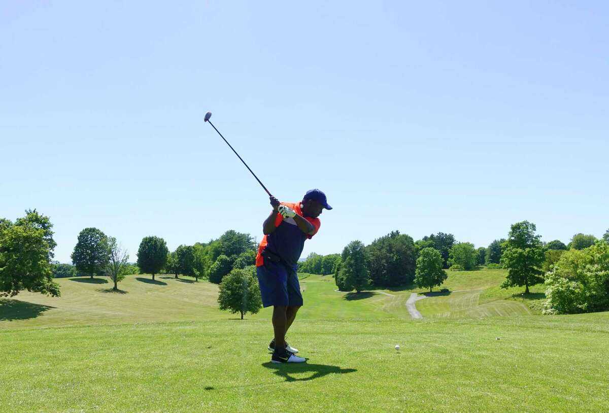 Hardy Rock of Albany hits a tee shot towards the first hole on opening day at Capital Hills Golf Course on Tuesday, June 16, 2020, in Albany, N.Y. (Paul Buckowski/Times Union)