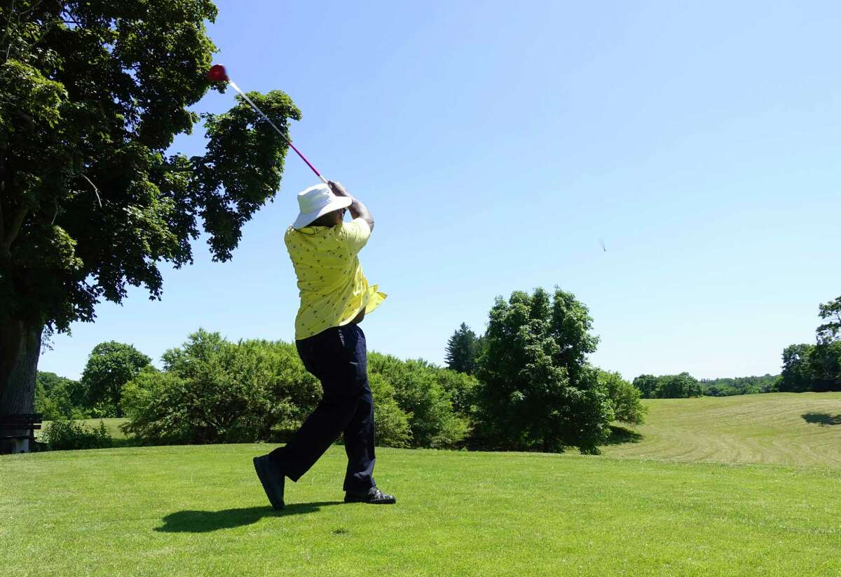 Keith Danzy of Albany hits a tee shot towards the first hole on opening day at Capital Hills Golf Course on Tuesday, June 16, 2020, in Albany, N.Y. (Paul Buckowski/Times Union)