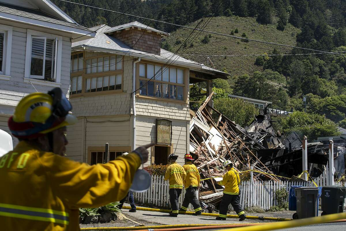 Firefighters at the site of an explosion along Shoreline Highway on Tuesday, June 16, 2020, in Stinson Beach, Calif.