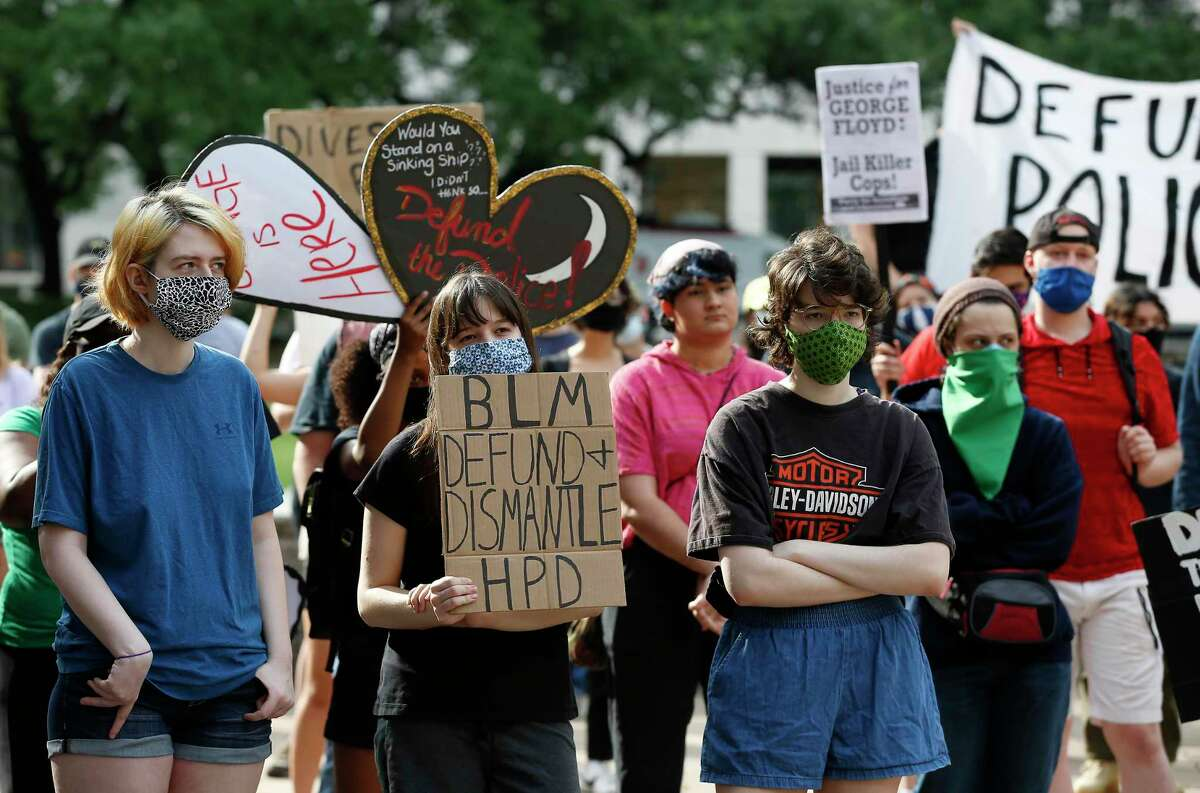 Protesters rally June 10 in support of city budget amendments to eliminate police misconduct.