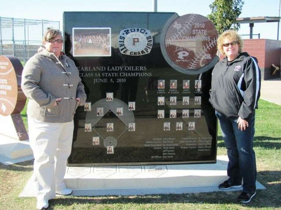 Pearland head softball coach Laneigh Clark, right, and associate head coach Michele Hydenpose alongside a monument dedicated to the Oiler's 2010 state championship softball team. Photo: SUBMITTED PHOTO / Submitted Photo