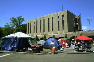 Protestors settle in for a fifth consecutive day at their encampment outside Bridgeport Police Headquarters in Bridgeport, Conn. on Monday, June 15, 2020. The protestors have asked to publicly air their demands in front of the Bridgeport City Council.
