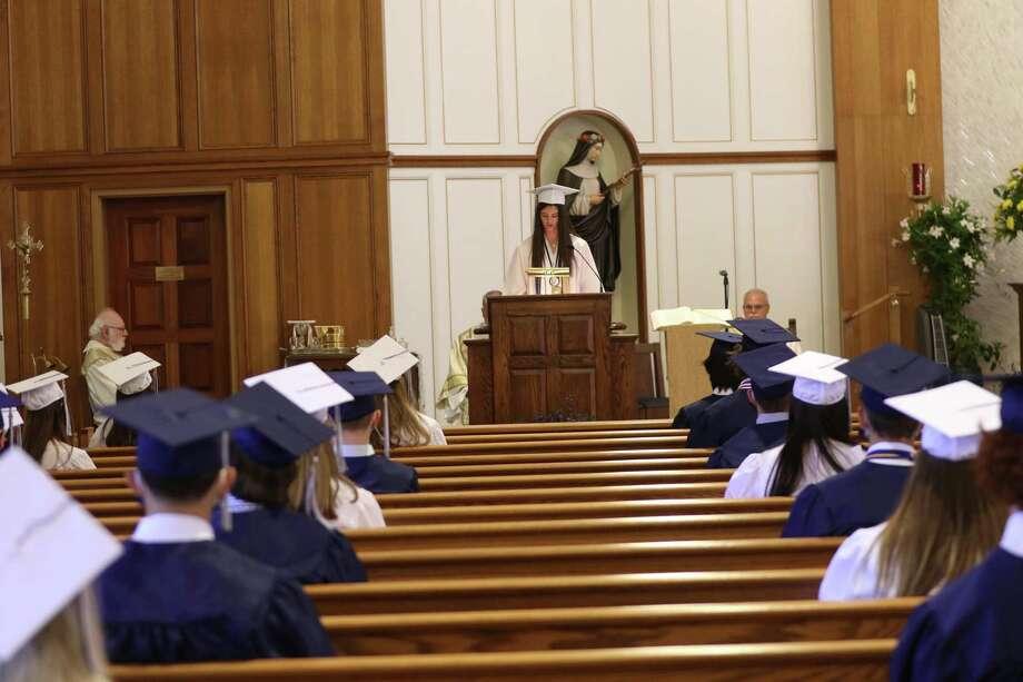 Mackenzie O'Rourke, of Brookfield, addressing her classmates at the podium at Immaculate High School's graduation on Saturday, June 13 at St Rose of Lima Church in Newtown. Photo: Contributed Photo / Contributed / The News-Times Contributed