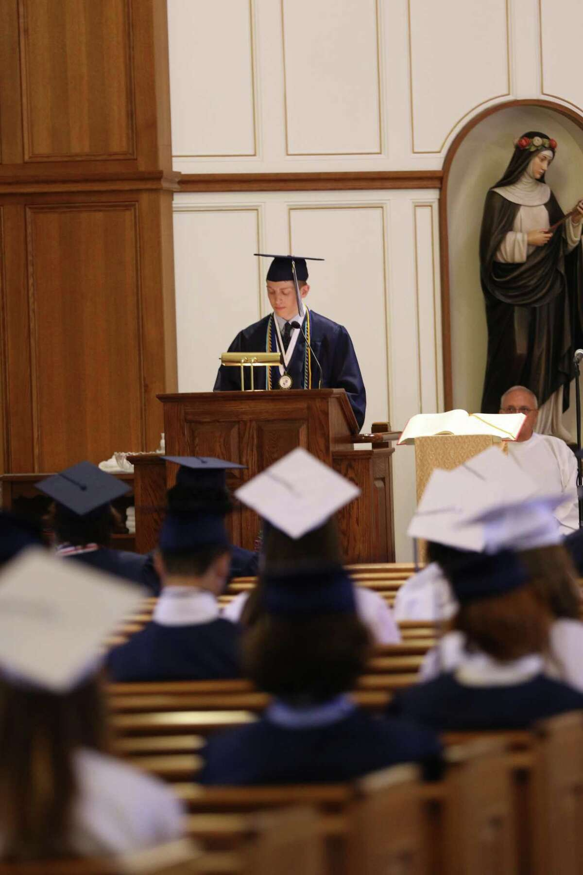 Valedictorian Hunter Kirkman, of Sandy Hook, gives his speech at Immaculate High School's graduation on Saturday, June 13 at St Rose of Lima Church in Newtown.