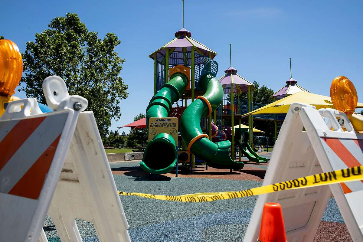 The playground at Heather Farm Park is seen closed due to the COVID-19 pandemic in Walnut Creek, Calif. Tuesday, June 9, 2020. They Bay Area is opening at a fairly fast pace, with Contra Costa County announcing plans this week to reopen indoor dining and hair salons soon, while it reports near-record new cases.