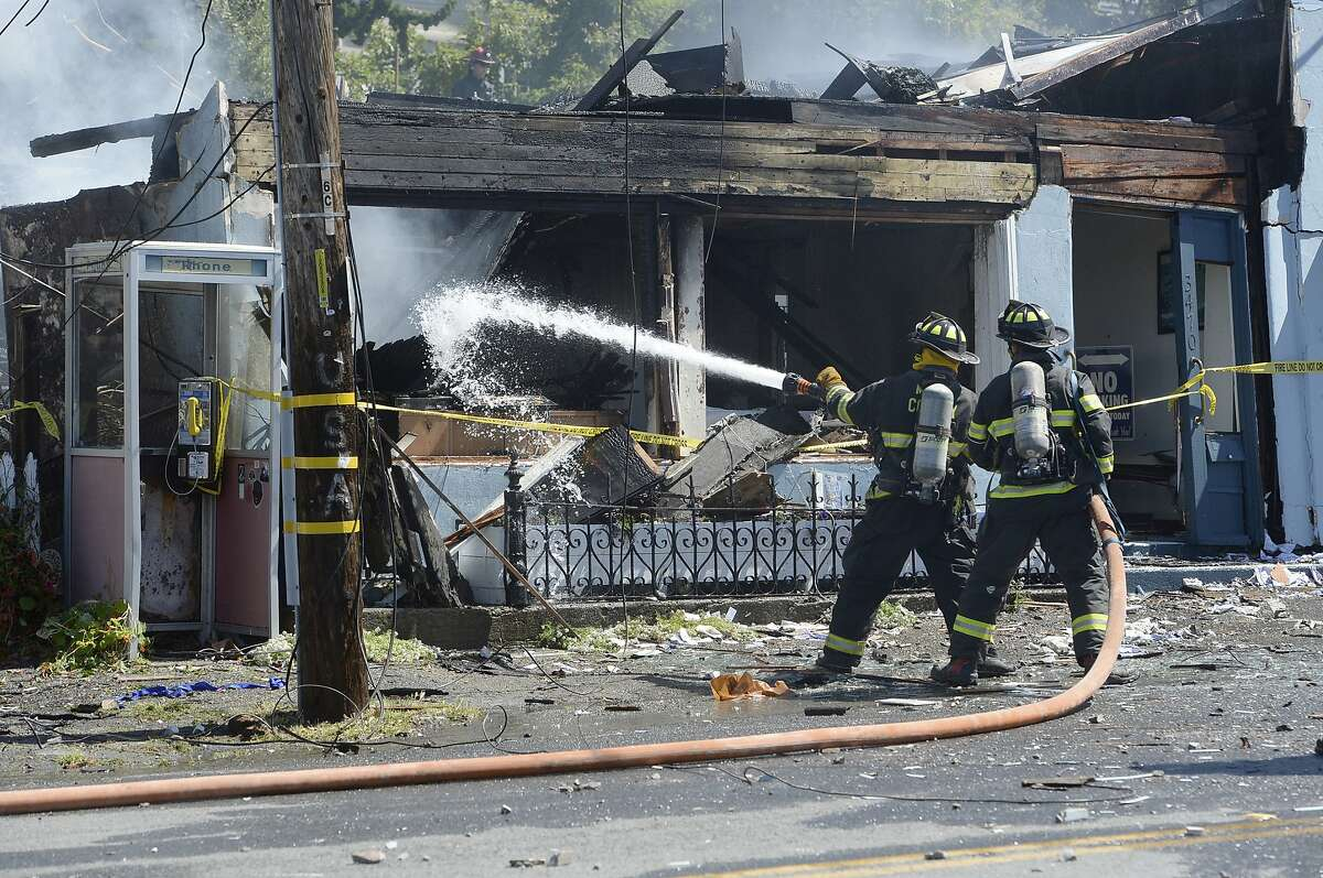 Firefighters work at the scene of a fire, which was preceded by an explosion, in downtown Stinson Beach, Calif. on Tuesday, June 16, 2020. Authorities closed Highway 1 after fire from an explosion spread to multiple buildings Tuesday in a beach community just north of San Francisco. (Alan Dep/Marin Independent Journal via AP)