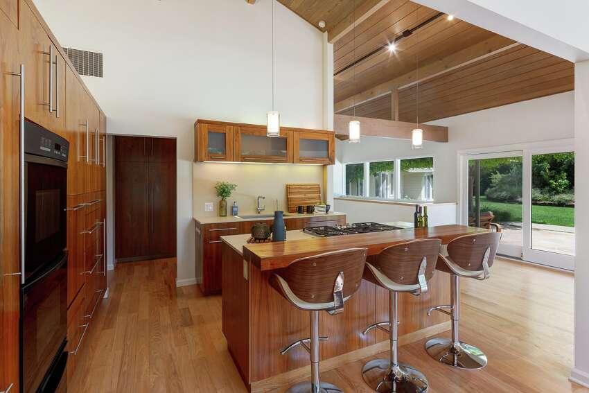 The kitchen is open, with upgrades that still harmonize with the intent of the home's 1961 origin.