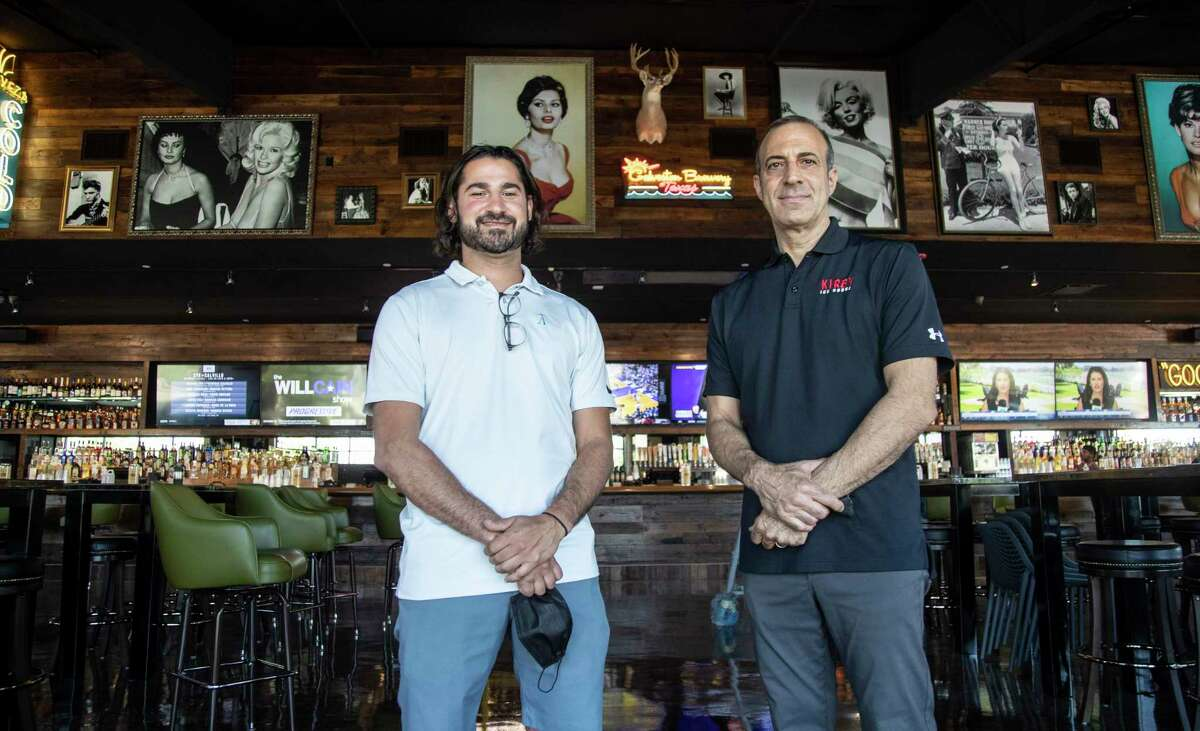 Russ Morgan, left, and Pete Antake, director of operations, are getting ready to open a second location of Kirby Ice House, at 1015 Gessner Road, which boasts the longest bar in Texas, Friday, June 12, 2020, in Houston. The original Kirby Ice House is a bar in Upper Kirby known for its huge yard and laid back vibe. The second location is across the Katy Freeway from Memorial City Mall.