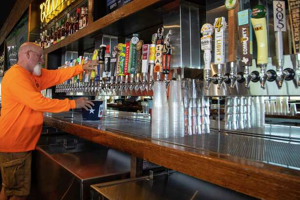 John Villars, owner of Texas Draught Werks, prepares the taps, at the a second location of Kirby Ice House, at 1015 Gessner Road, Friday, June 12, 2020, in Houston. The original Kirby Ice House is a bar in Upper Kirby known for its huge yard and laid back vibe. The second location is across the Katy Freeway from Memorial City Mall.