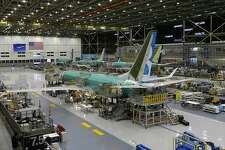 FILE - This Dec. 7, 2015, file photo shows the second Boeing 737 MAX airplane being built on the assembly line in Renton, Wash. Pressure is growing in Congress for at least modest changes in how federal regulators approve new passenger planes after two deadly crashes involving the Boeing 737 Max. On Tuesday, June 16, 2020, two key senators on transportation issues proposed several changes that would increase Federal Aviation Administration's direct role in the aircraft-certification process. (AP Photo/Ted S. Warren, File)