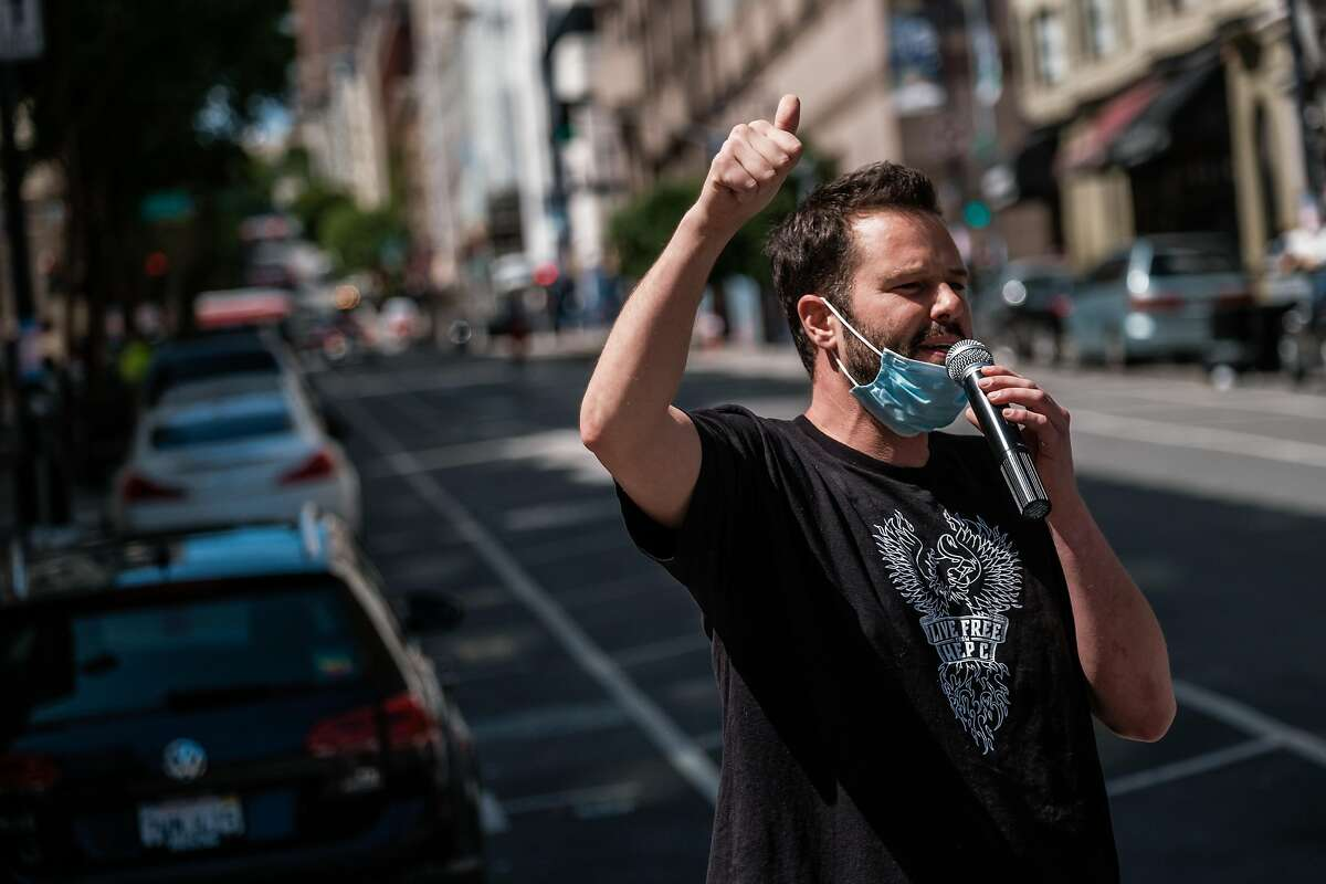 Supervisor Matt Haney speaks at a protest in the Tenderloin to demand more sanitation stations and street and parking closures to allow for social distancing in San Francisco on Friday, May 22, 2020.