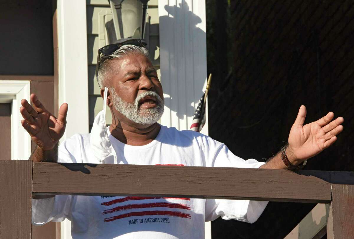 Mohammed Hossain speaks from his front porch to people who gathered in front of his home to greet him after his release from federal prison on Tuesday, June 16, 2020 in Albany, N.Y. Hossain is still in home confinement. (Lori Van Buren/Times Union)