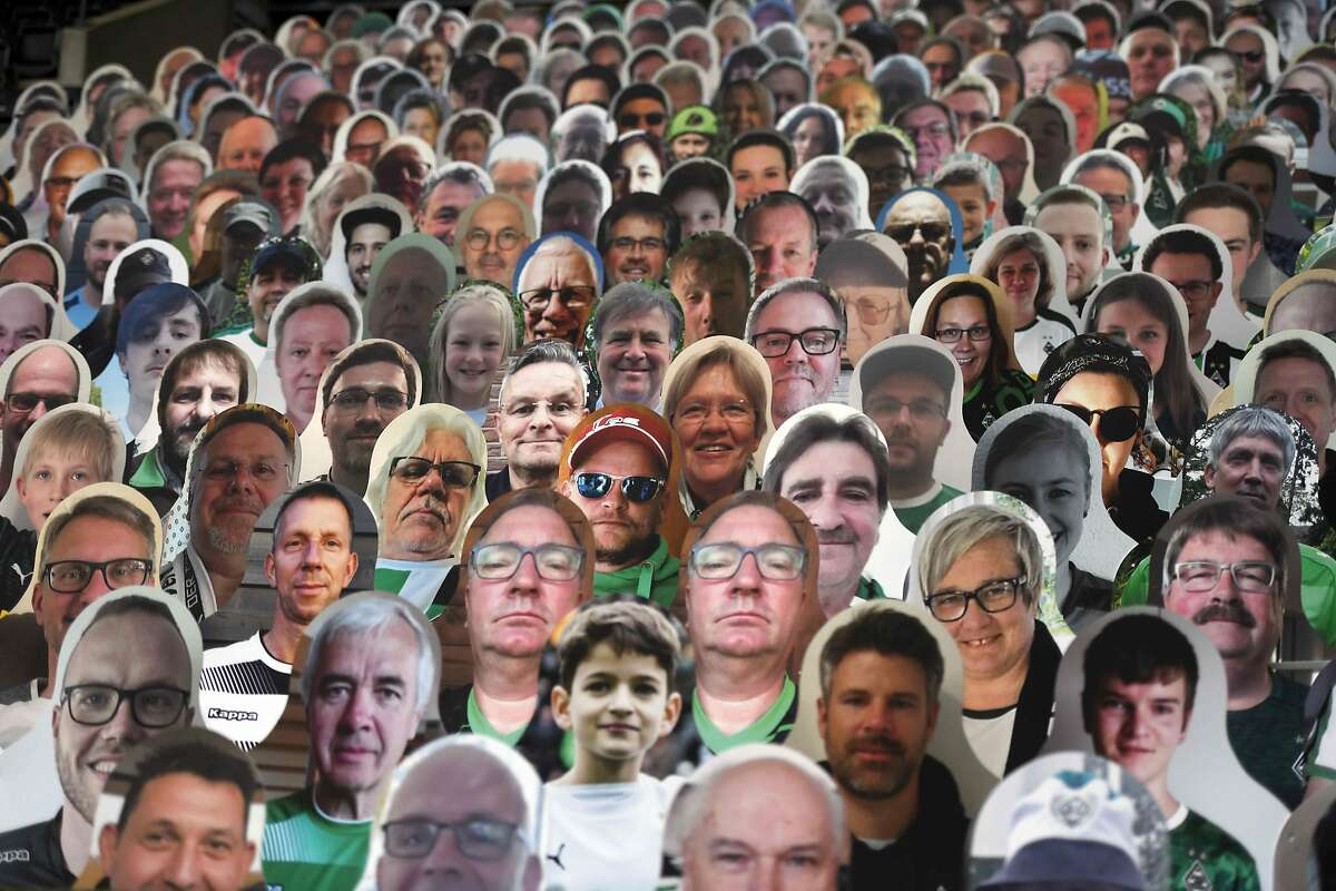 Cardboard pictures of fans are pictures ahead the German first division Bundesliga football match Borussia Moenchengladbach v Bayer 04 Leverkusen on May 23, 2020 in Moenchengladbach, Germany.
