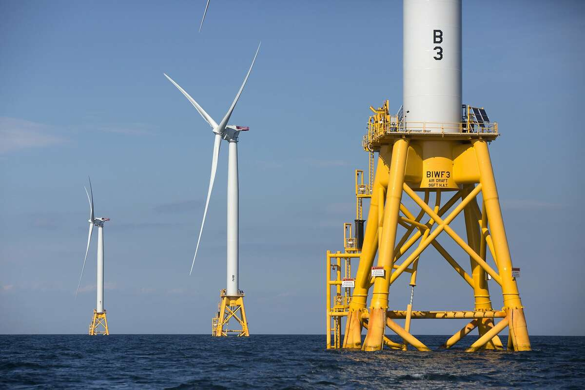 FILE - In this Aug. 15, 2016 file photo, three of Deepwater Wind's five turbines stand in the water off Block Island, R.I.