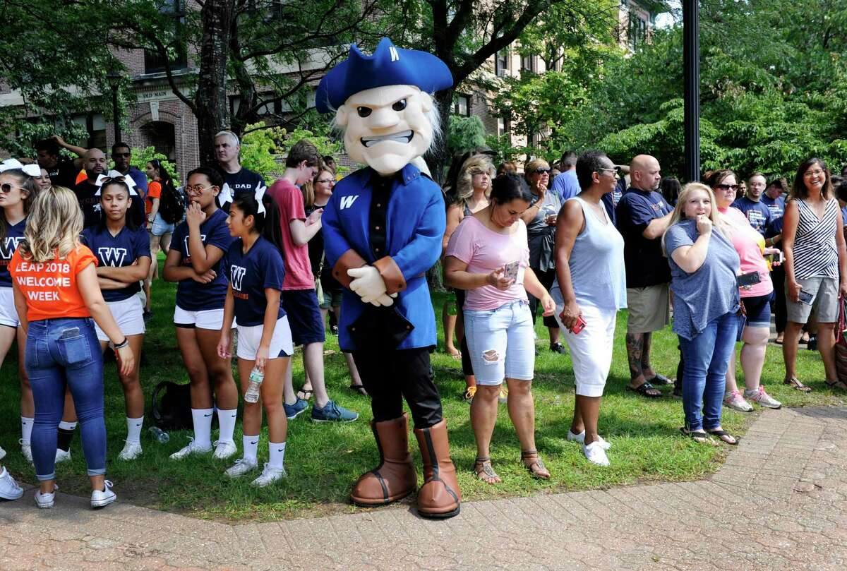 """Colonial Chuck greets freshmen at WestConn as they move into dorm rooms on campus in Danbury on Aug. 24, 2018. The university is preparing to change its mascot, as some students find """"Colonials"""" has negative associations."""