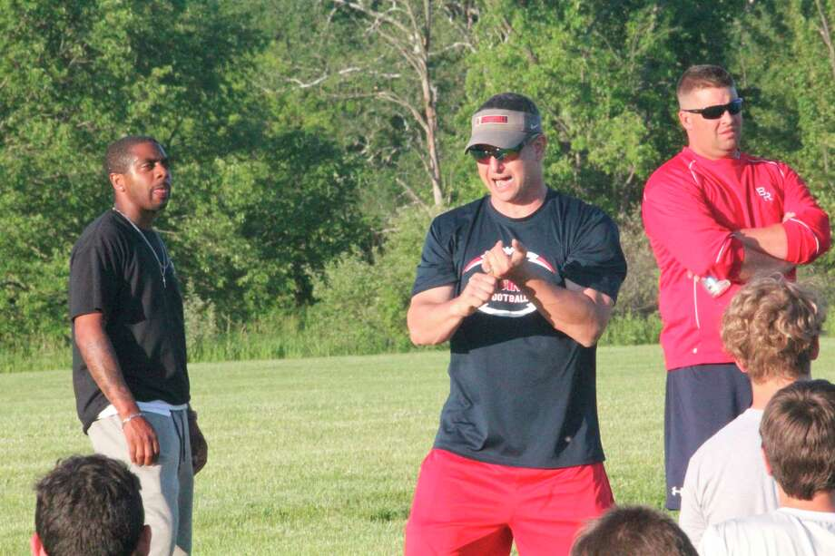 Big Rapids football coach Milke Selzer (middle) talks to his players after a Monday workout. (Pioneer photo/John Raffel)