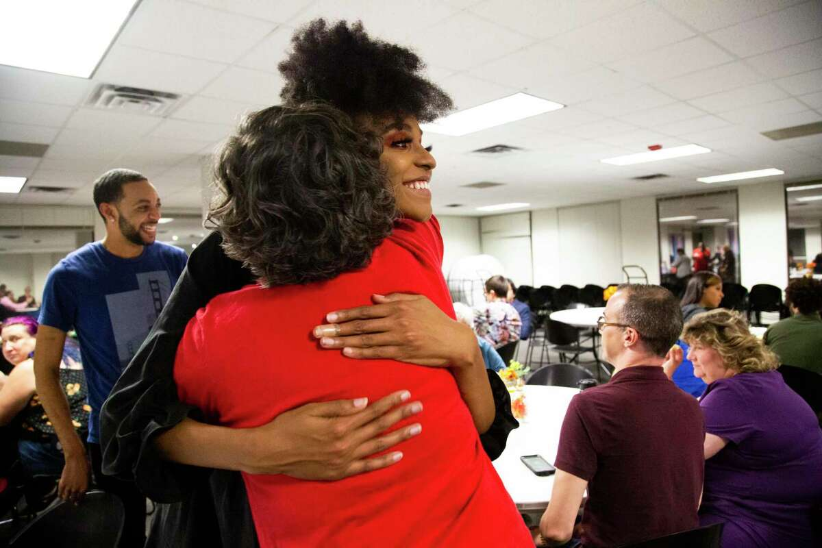 Jessica Zyrie embraces Erika Richie at the Annual Transgender Community Thanksgiving Potluck & Party in the Montrose Center on Tuesday, Nov. 26, 2019, in Houston. The event has been a tradition of the Houston's transgender community since the 1990s.