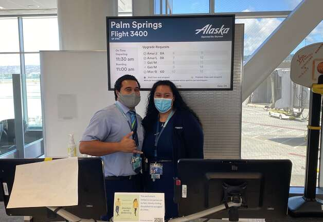 """At the gate, I again said, """"Hello, I'm smiling behind this mask"""" to the friendly duo manning the gate. They said they were smiling, too. Photo: Chris McGinnis"""