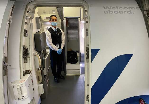 As I boarded, a friendly (I think) flight attendant was greeting passengers enthusiastically from behind his mask. I wondered if airlines now instruct staff to genuflect more to help express positivity since they can't use their masked faces to communicate non-verbally. Photo: Chris McGinnis