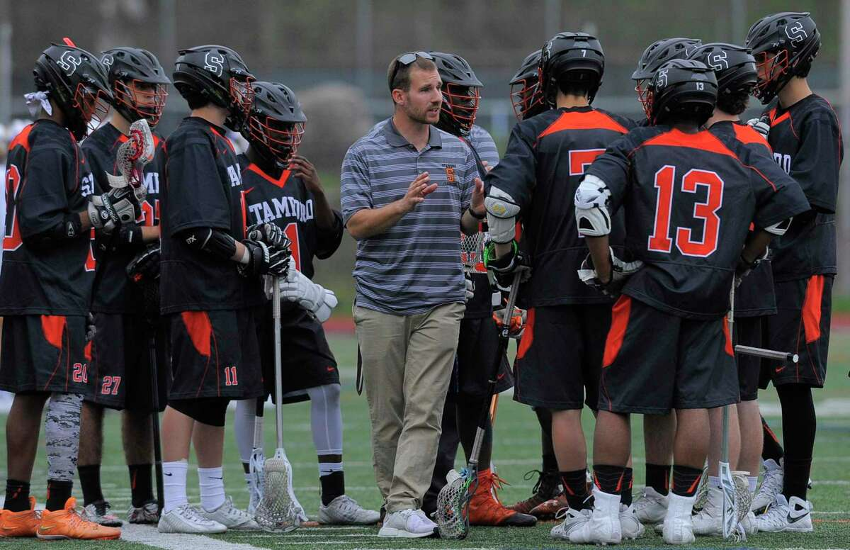 Stamford coach Mike Nazzaro talks with his players during a timeout in a varsity boys lacrosse game against Westhill at Westhill High School's J.Walter Kennedy Stadium in Stamford on April 27, 2017. Nazzaro is extremely proud of how far the Stamford city lacrosse feeder program has come, leaving him with plenty of experienced players coming out for the team even with a year off due to the pandemic.