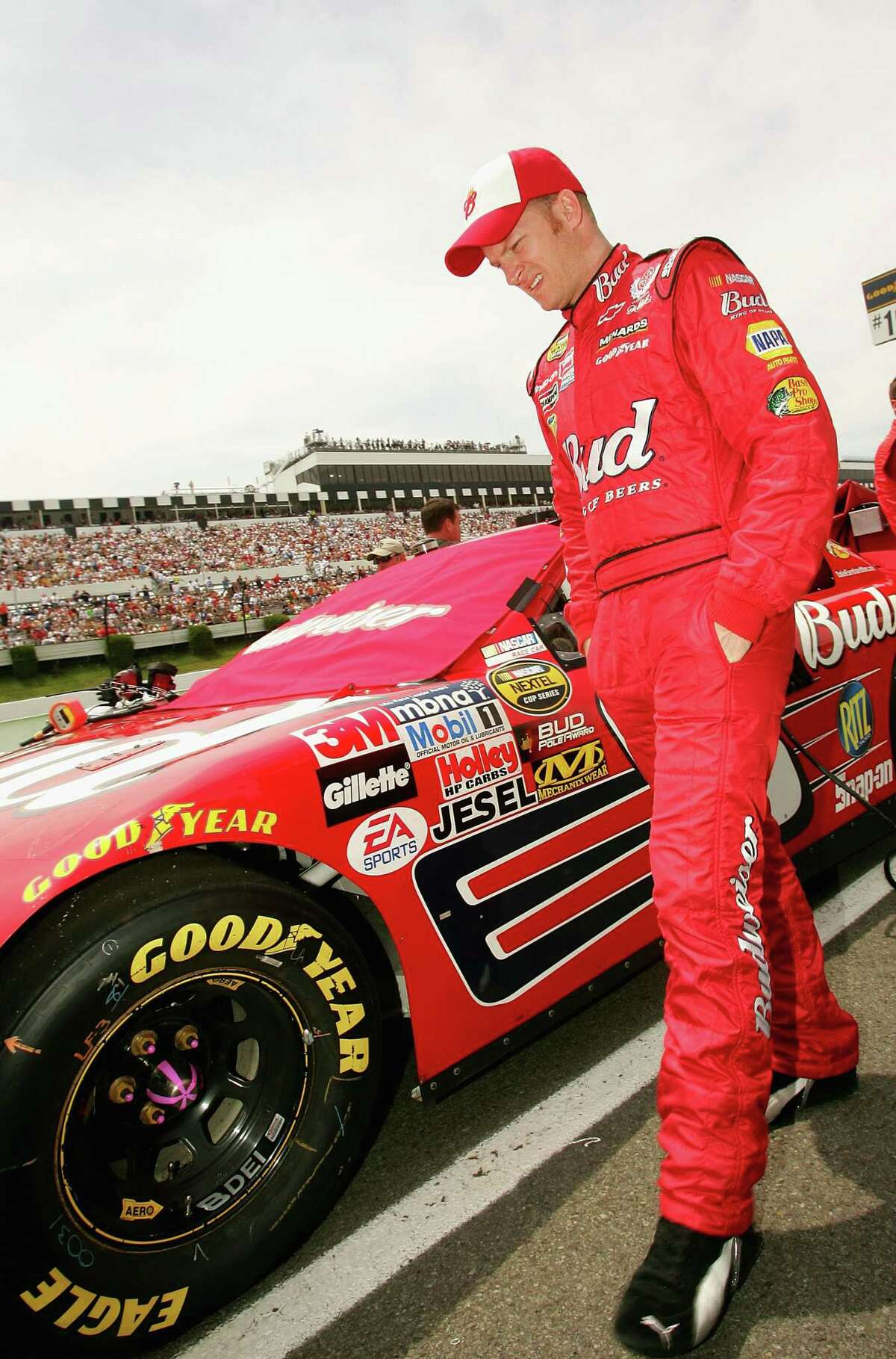 LONG POND, PA - JUNE 12: Dale Earnhardt Jr., driver of the #8 Budweiser Chevrolet, walks on the grid during the NASCAR Nextel Cup Pocono 500 on June 12, 2005 at Pocono Raceway in Long Pond, Pennsylvania. (Photo by Nick Laham/Getty Images)