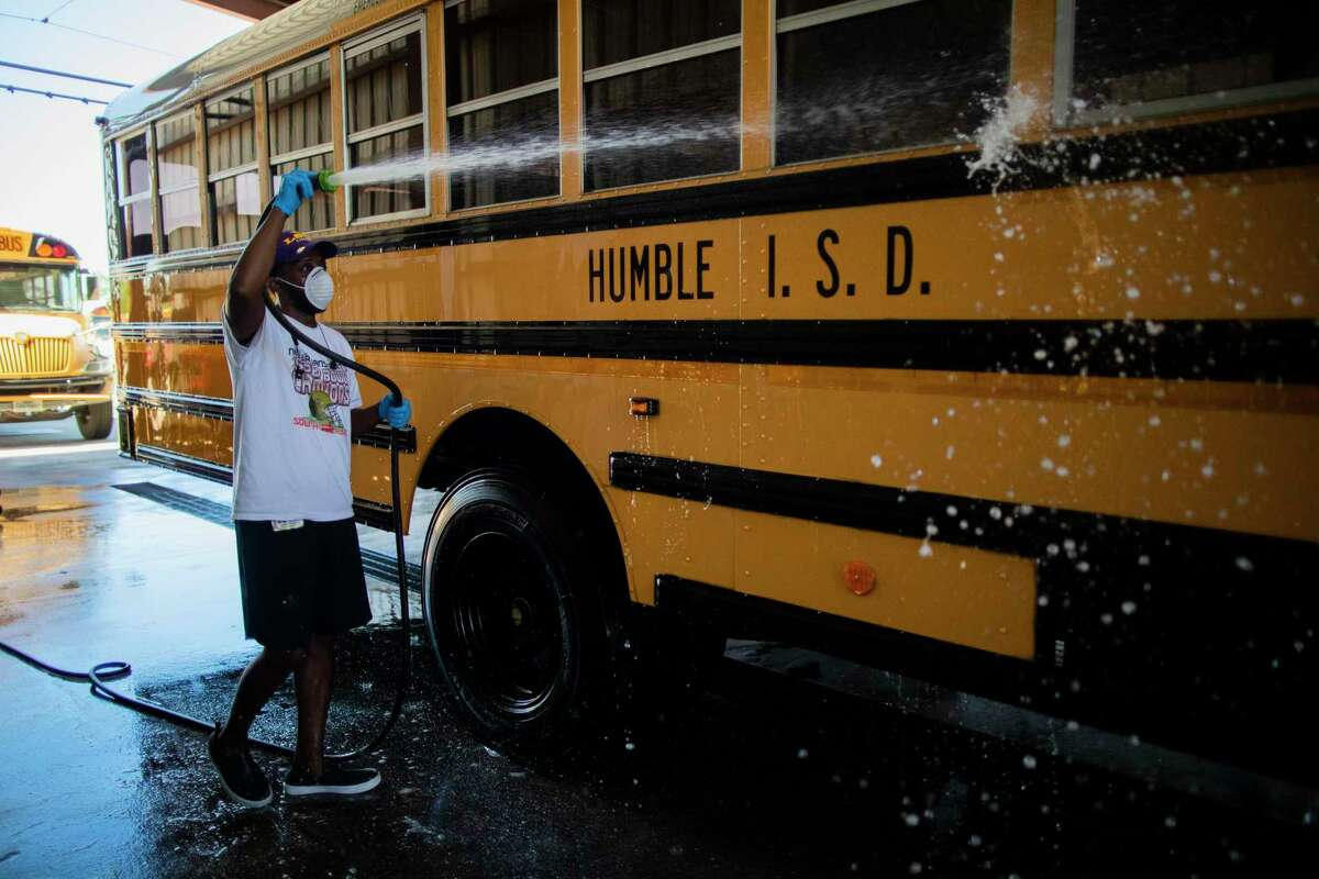 Humble ISD mechanic Jessie Peoples bus washes an Humble ISD on Thursday, June 11, 2020, in Humble in preparation for the new school year.