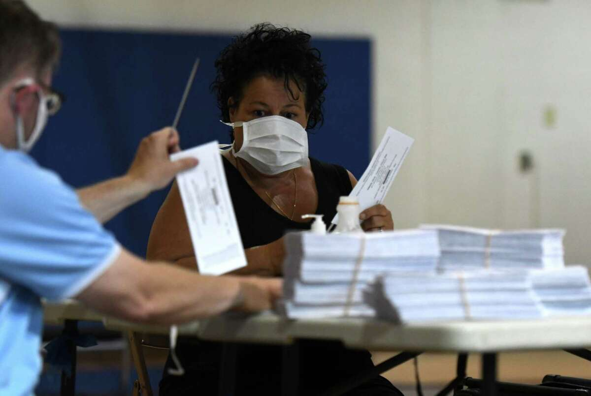 Albany City School District budget and election ballots are prepared for counting by district employees and community members on Tuesday, June 16, 2020, at Arbor Hill Elementary School in Albany, N.Y. The school ballots will all be counted by hand. (Will Waldron/Times Union)