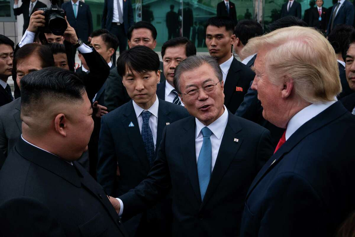 FILE -- President Donald Trump, right, President Moon Jae-in of South Korea, center, and and Kim Jong Un, left, the North Korean leader, speak outside the Freedom House on the South Korean side of the truce village of Panmunjom, June 30, 2019. North Korea on Tuesday, June 16, 2020, blew up a building where its officials and their South Korean counterparts had recently worked side by side, dramatically signaling its displeasure with the South after weeks of threats to end the countriesa€™ recent detente. (Erin Schaff/The New York Times)