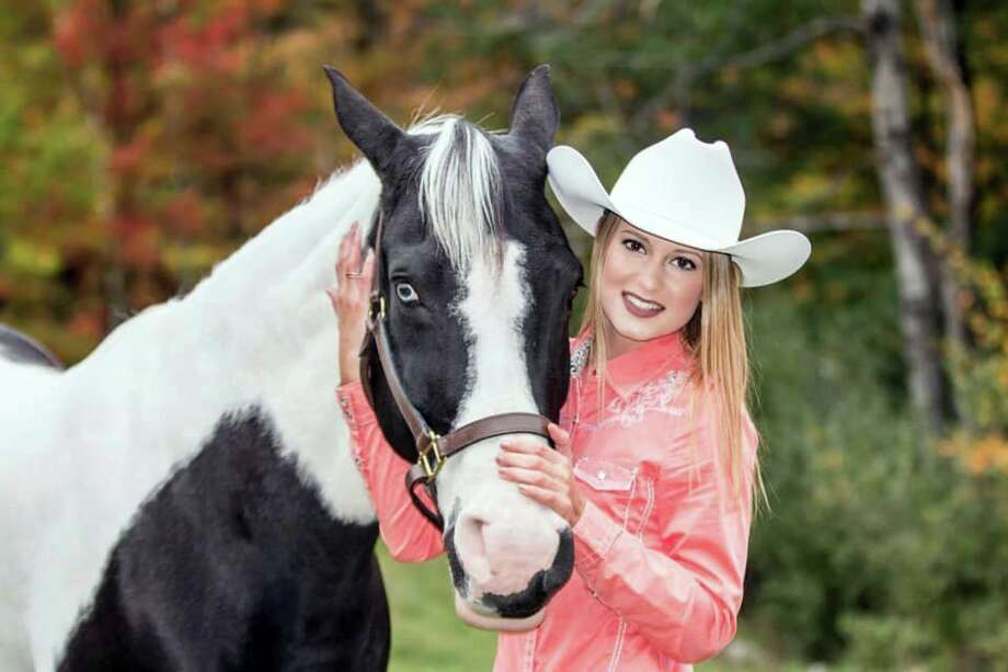 Nineteen-year-old Brooke Voelker shares a smile with her horse, Sierra, for the camera. Voelker has been involved with the Mecosta County Free Fair since a young age. Unfortunately, she was unable to participate this year, her final year, due to the coronavirus. (Photo courtesy of Brooke Voelker)