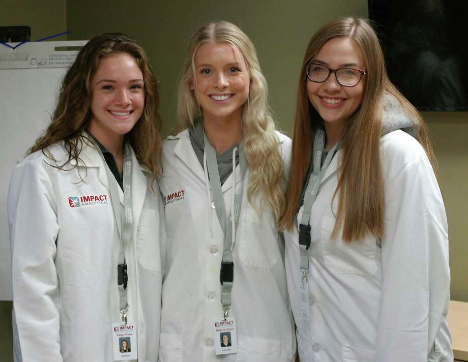 Impact Analytical doubled its internship capacity this year, welcomingbiochemistry majors Paige Prime, left, Brianna Ecton, center, and Alexis Samalik, right. (Photo provided)
