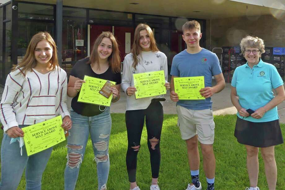 (From left to right) Jaylynn Talsma, Chelby Talsma, Mae Talsma and Zach Grundy receive Service Above Self recognition from Sunrise Rotary's Val Gerhart. (Submitted photo)