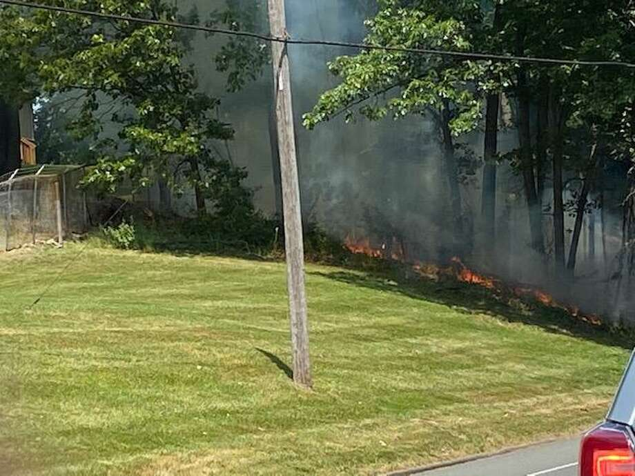 Firefighters responded to a fire that temporarily stopped traffic on Trap Falls Road. Photo: Theresa O'Malley / Contributed Photo / Connecticut Post