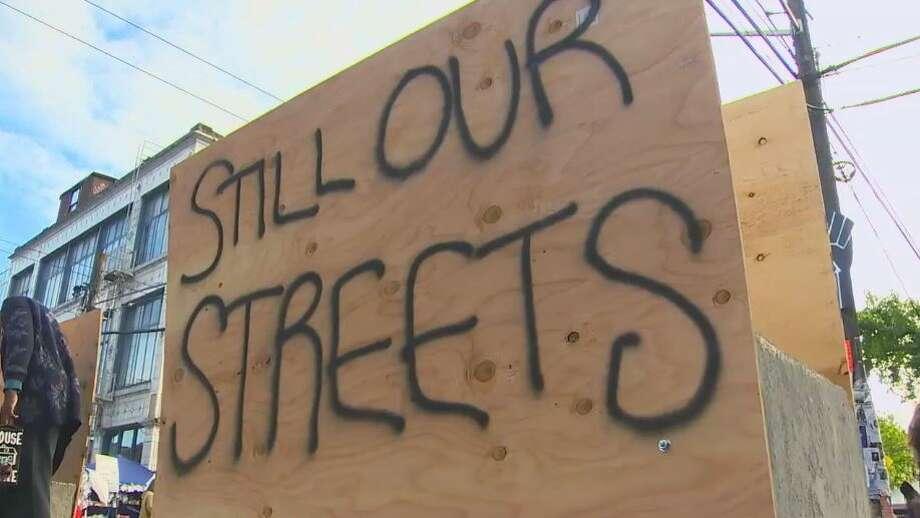 Protesters block new CHOP traffic lane hours after it opens. Photo: Courtesy Of KOMO News