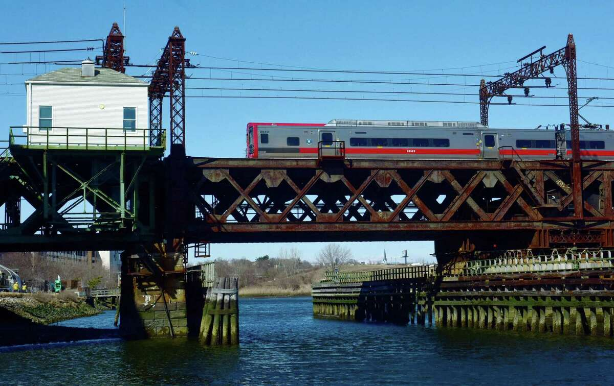 A Metro-North commuter train travels southbound over the Walk Bridge in Norwalk.