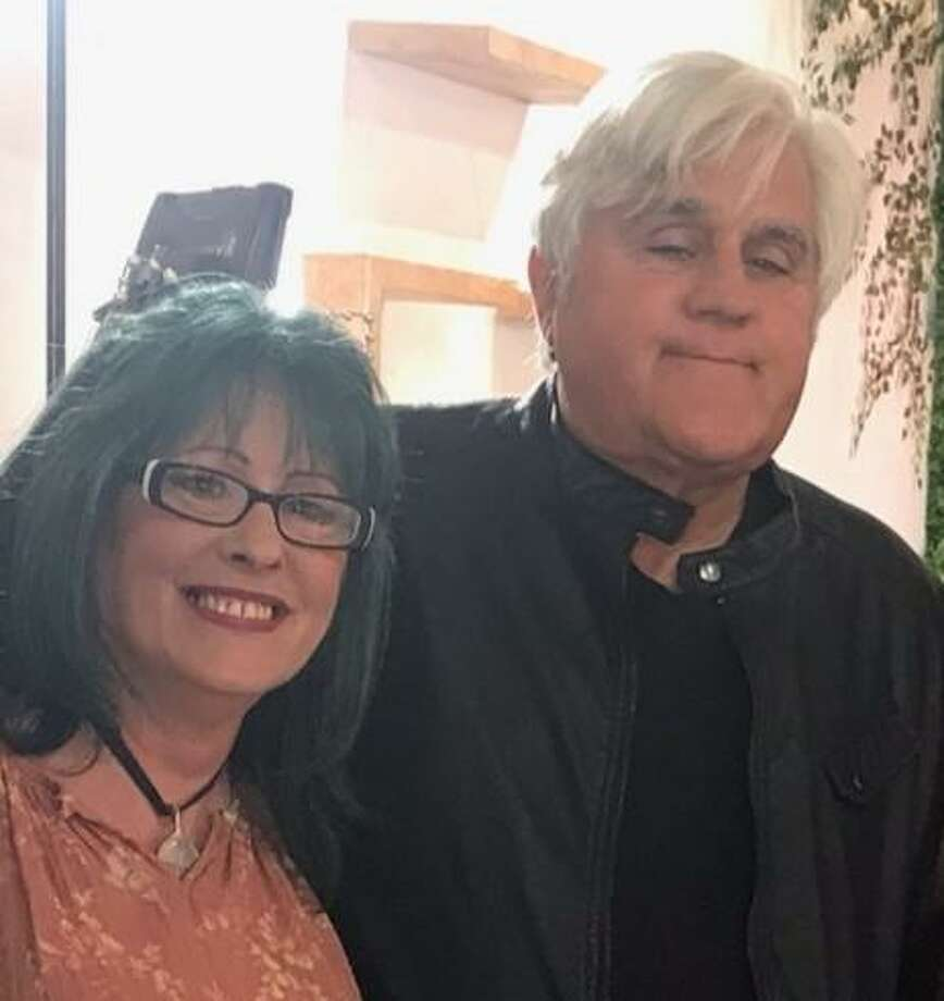 Montgomery art car artist Kimi Bainter is pictured with comedian Jay Leno. Bainter will be on Jay Leno's Garage Show on July 1 on CNBC at 9 p.m. Photo: Submitted Photo