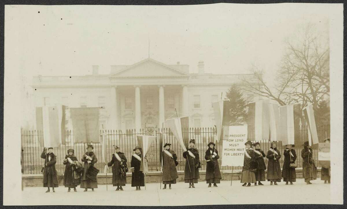 Suffragists protesting in front of the White House, 1917-1919.