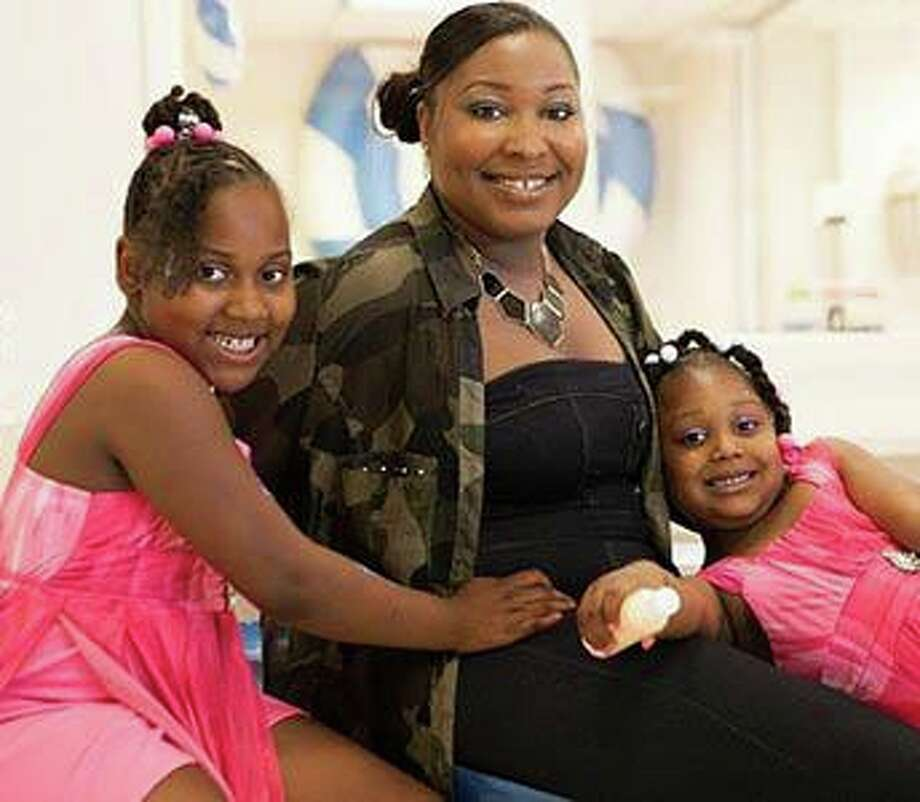 New Haven resident Barnetta Haywood and her daughters. Photo: Marisa Balletti-Lavoie / / Sassy Mouth Photography