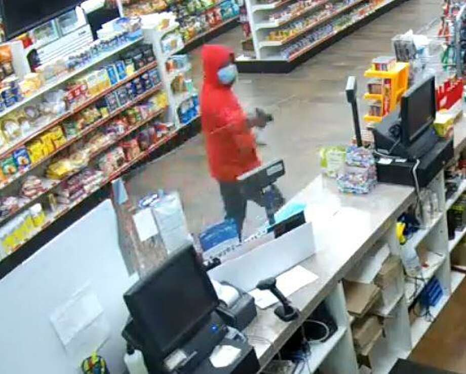 A men using a handgun to rob the Mobil gas station and convenience store at 904 West Main Street on Tuesday, June 16, 2020. Photo: Stamford Police Department / Contributed