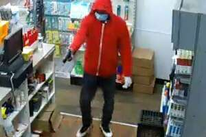 A man uses a handgun to rob the Mobil gas station and convenience store at 904 West Main Street on Tuesday, June 16, 2020. On the same evening, a man wearing the same clothes robbed the West Main Street Grocery — which has been held up three times this year.